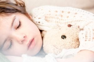 toddler sleeping with teddy