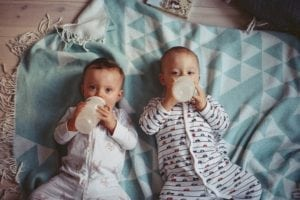 babies drinking bottles of milk