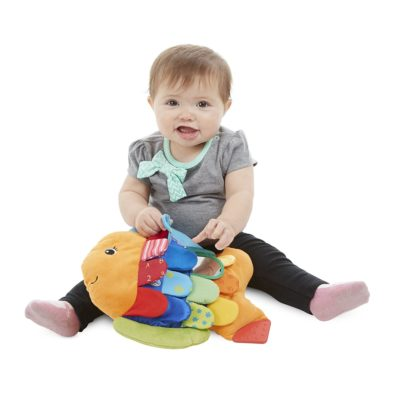 Washable fabric toy with baby includes a variety of textures and colors