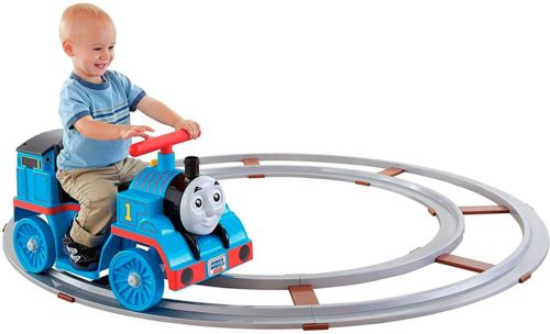 toddler riding a ride on thomas train power wheel toy
