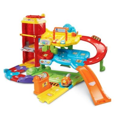 interactive toy car garage and race vehicles around toy with car slides - red, yellow and blue colours