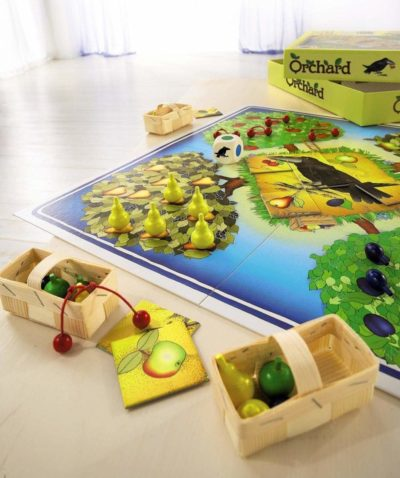 Orchard Game on display with small pieces on the board game
