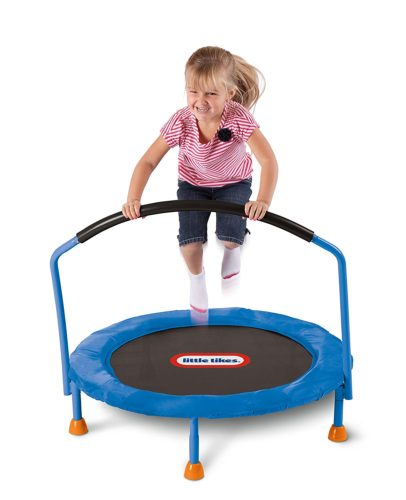 girl toddler playing on trampoline for toddlers