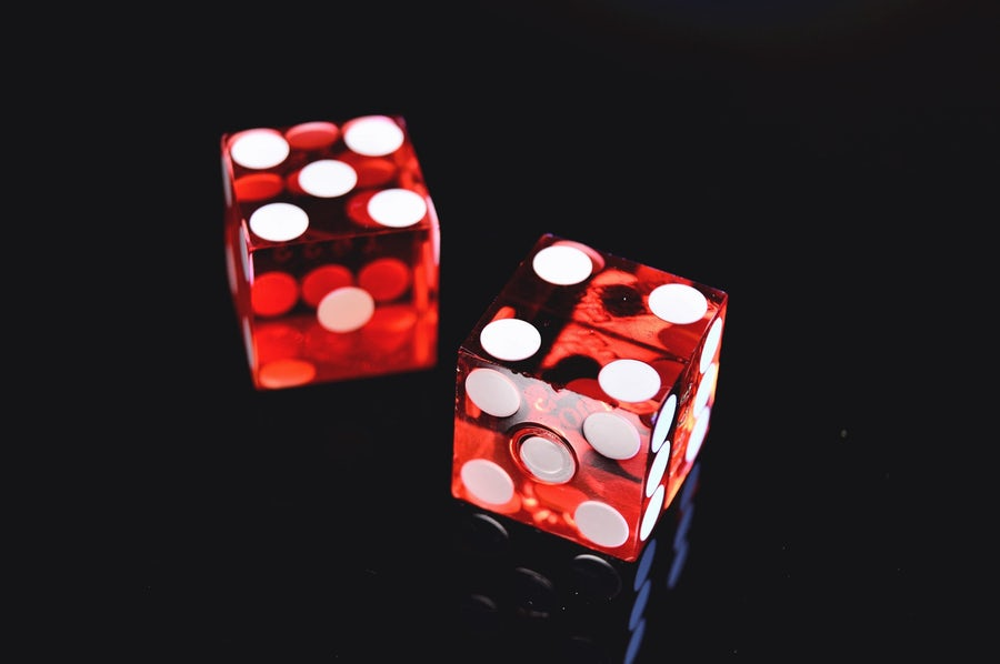 two red dice showing numbers 4 and 5