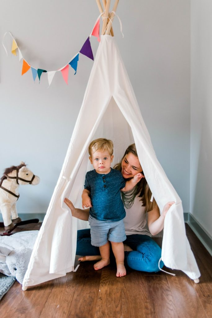 boy and mother in white tipi tent