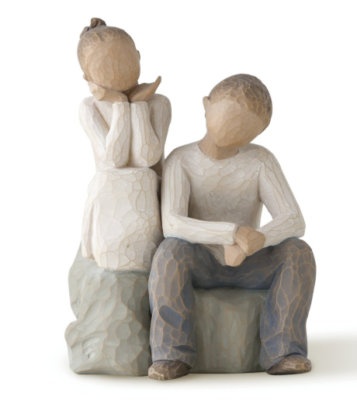 This is an image of a sculpted hand painted figure of a sister and brother.