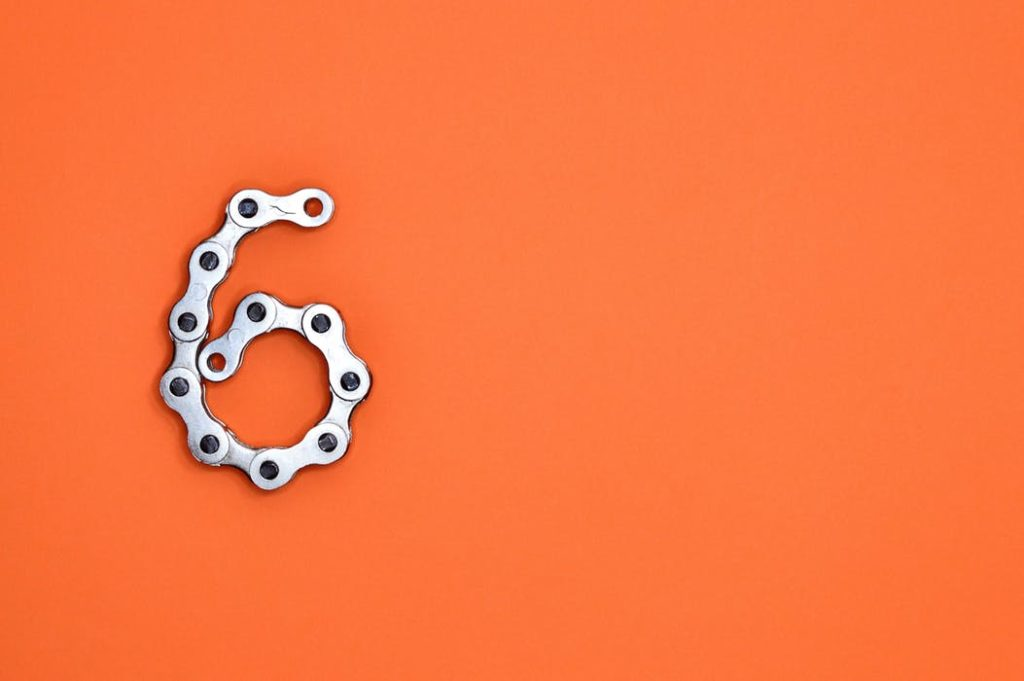 number 6 made from chain on an orange background