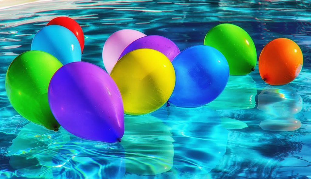 brightly colored balloons floating on water