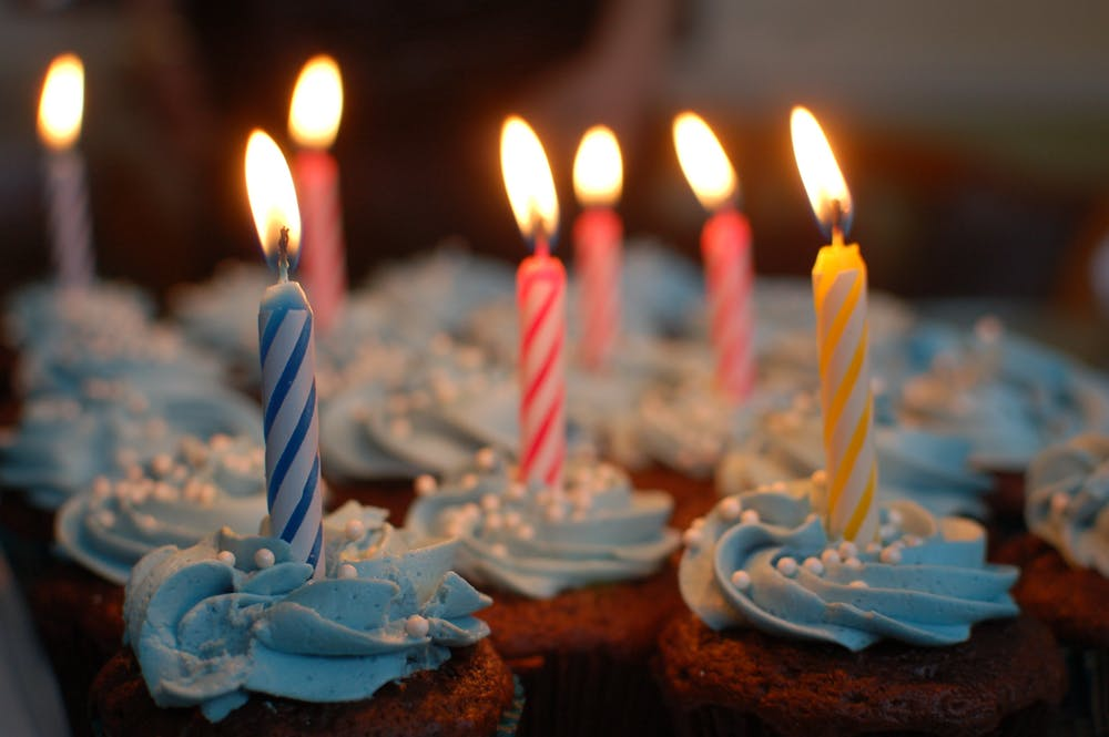 this is an image of blue birthday cupcakes