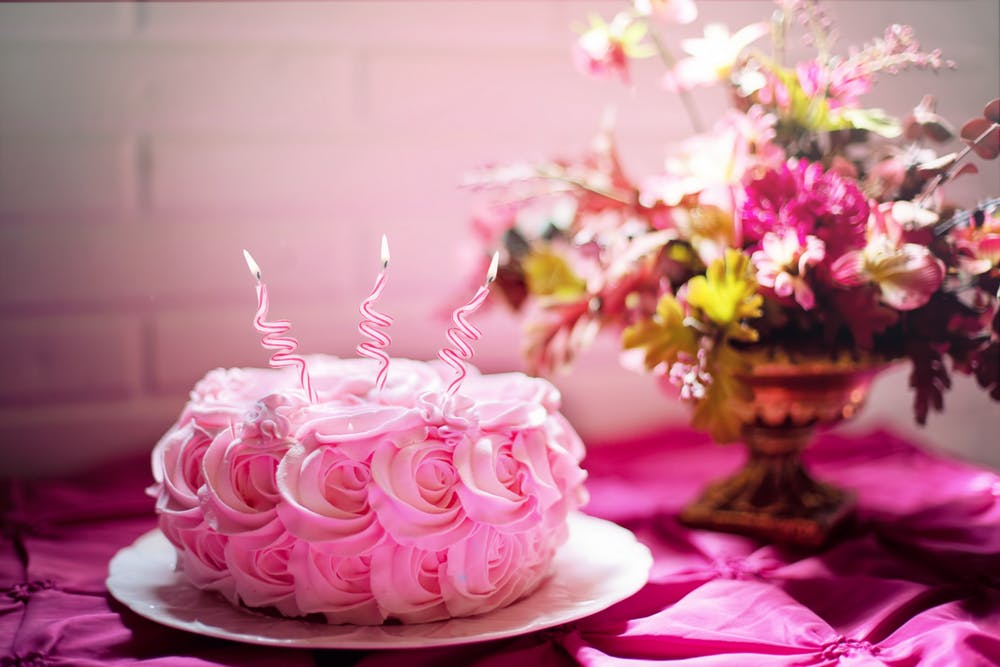 this is an image of a pink birthday cake