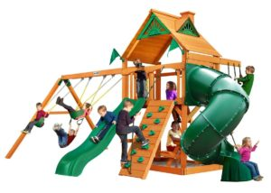 large wooden swing set with tube slide