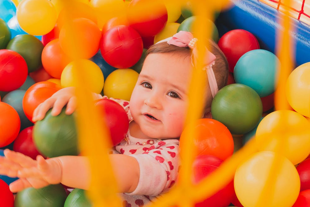 baby girl in a ball pit