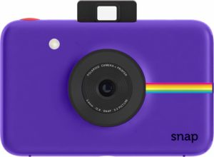 this is an image of an instant camera in purple