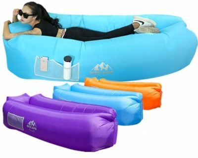 This is an image of a lady lying on the inflatable sofa.
