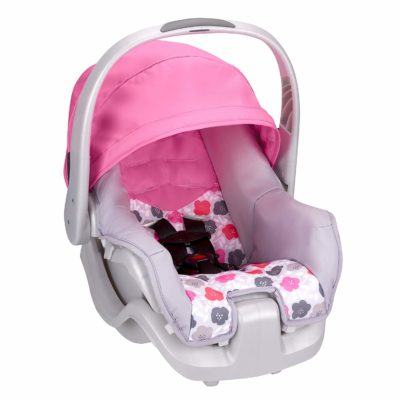 This is an image of a pink bloom Nurture car seat by Evenflo.