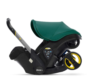 this is an image of a doona car seat in racing green
