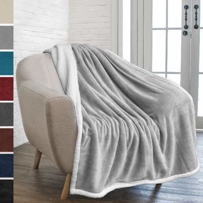 This is an image of a light grey throw blanket by Pavilia.
