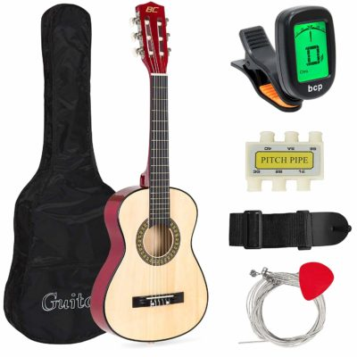 This is an image of an acoustic guitar for beginners with bag, picks, e tuner and strap.