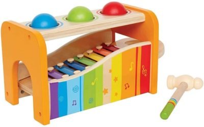 This is an image of Hape Pound & Tap Bench with Slide Out Xylophone - Award Winning Durable Wooden Musical Pounding Toy for Toddlers, Multifunctional and Bright Colours