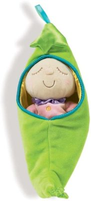 This is an image of a baby doll inside a green sleep sack.