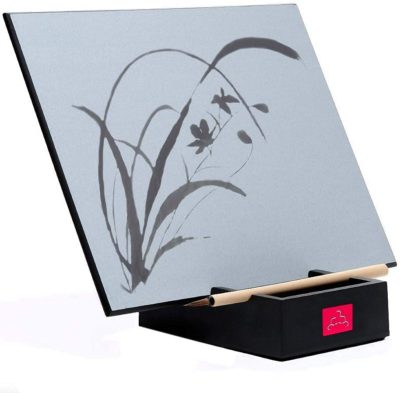 This is an image of a water painting board with bamboo paint brush.