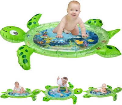 This is an image of a baby on top a green turtle water mat.