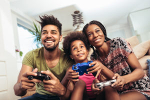this is an image of a family playing a video game together