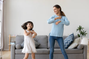 this is an image of a family dancing together
