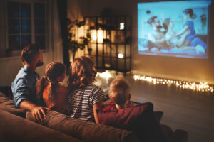 this is an image of a family having a home cinema