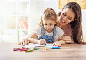 this is an image of a mom and daughter drawing together