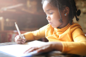 this is an image of a girl writing a story