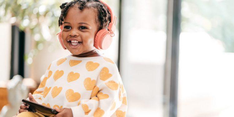 Toddler enjoying educational videos with headphones on