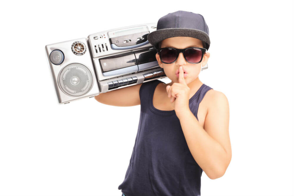 kid holding a boombox